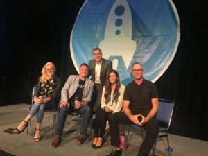 Group of entrepreneurs on stage | San Diego: Life. Changing.